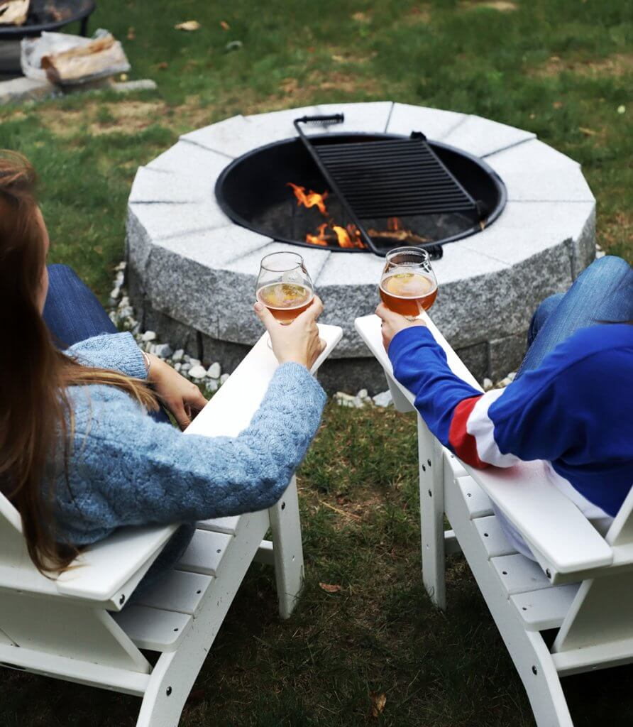 Image of a couple enjoying a beverage at a fire pit